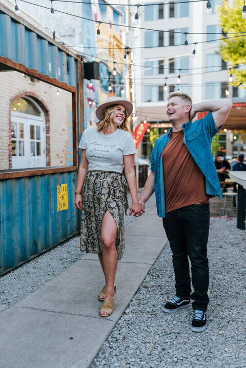 Couple laughing downtown