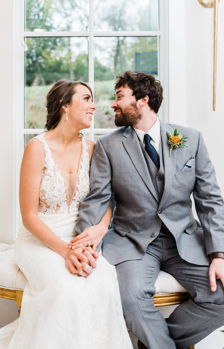 Newlyweds smile at each other
