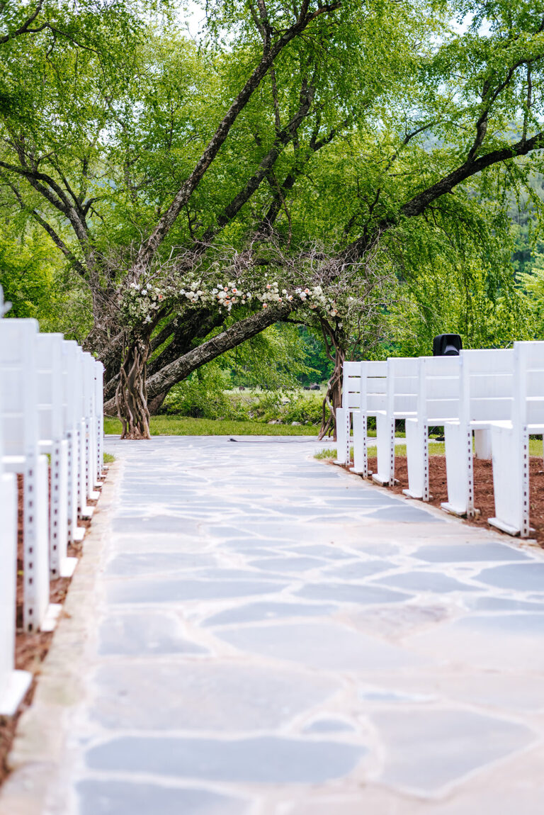 Empty ceremony site with floral arch at front